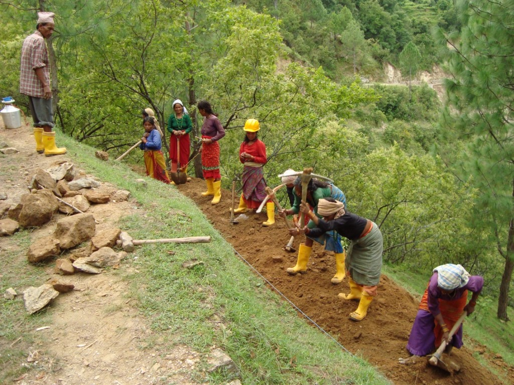Women preparing foundations for rural roads . Credit: RAP 3 staff.