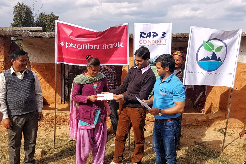 Mr Joshi, Dhanghadi Branch Manager, Prabhu Bank Limited (PBL), handing over a cheque book to Mina Kumari Namjali, one of 30 ginger farmers who have obtained loans  from PBL, thanks to CONNECT facilitation, Doti, 3rd March 2017. Credit: Mr Narayan Kumar Thapa, RAP 3 staff.