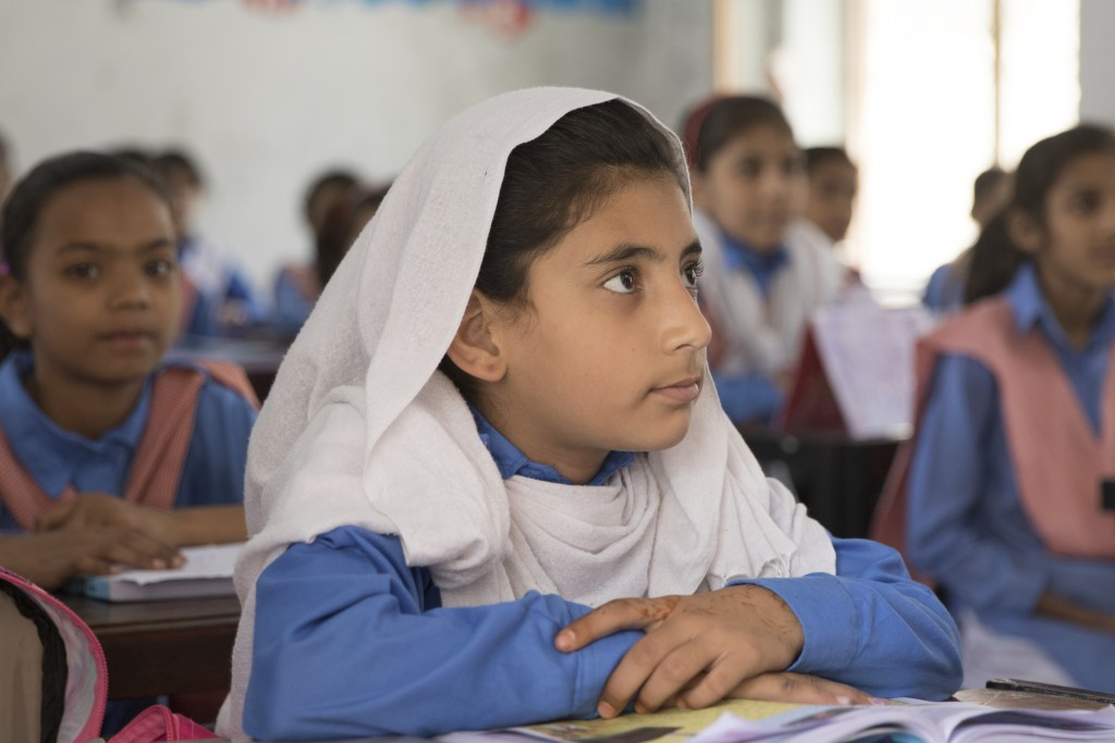 One of the schoolchildren who is benefiting from an  improved learning environment thanks to the Humqadam  programme. Credit: Humqadam programme team.