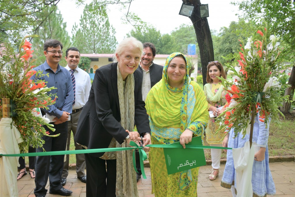 DFID Pakistan Deputy Head Judith Herbertson cuts the ribbon at the library inauguration ceremony in Islamabad on 31 July.