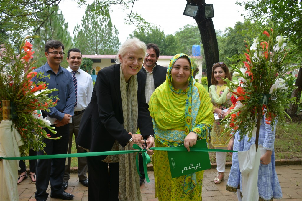 Deputy Head DFID Pakistan Judith Herbertson (left) and Principal Sajida  Bibi (right) inaugurate a new library donated by UK Aid and IMC to a  primary school in Pakistan's capital Islamabad in July 2017.
